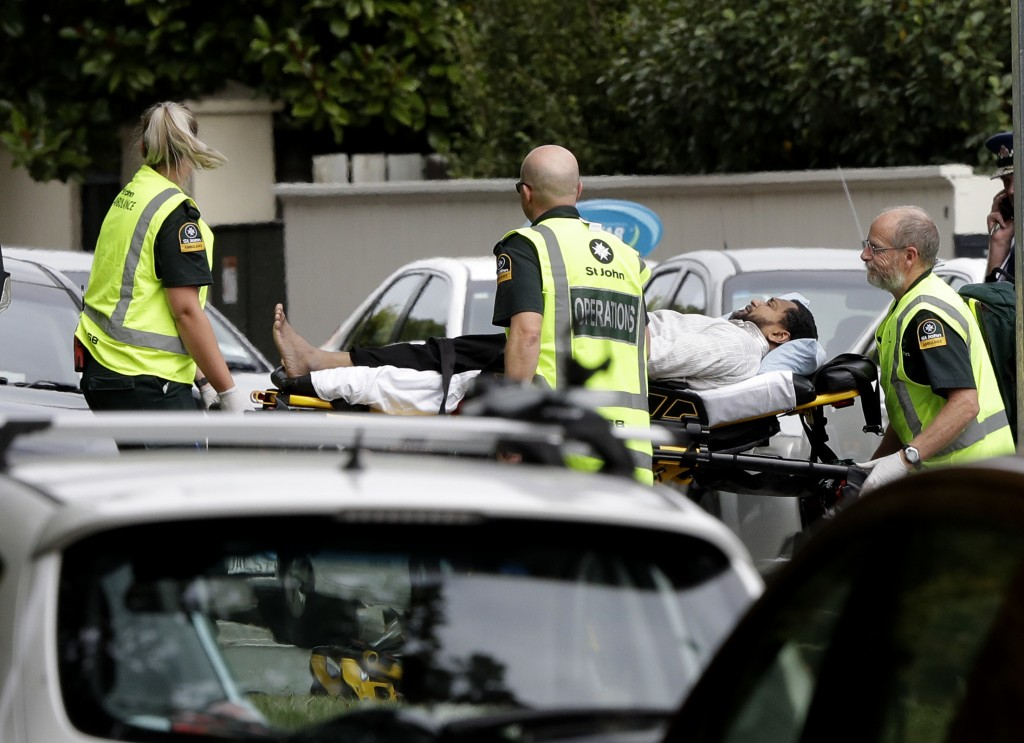 Ambulance staff take a man from outside a mosque in central Christchurch, New Zealand, Friday, March 15, 2019. A witness says many people have been ki
