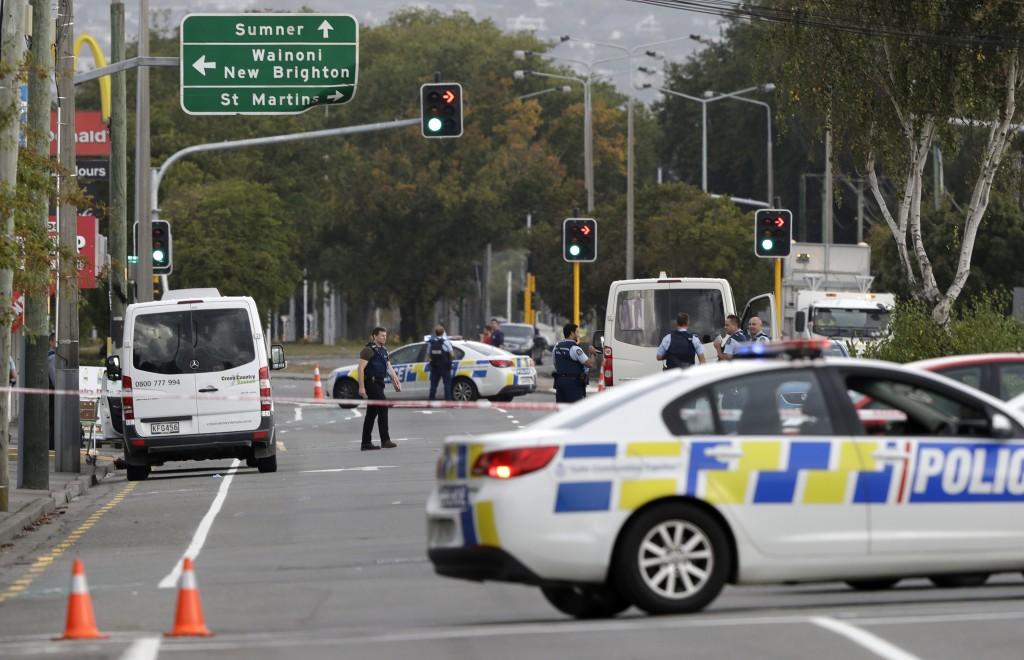 Police block the road near the shooting at a mosque in Linwood, Christchurch, New Zealand, Friday, March 15, 2019. Multiple people were killed during
