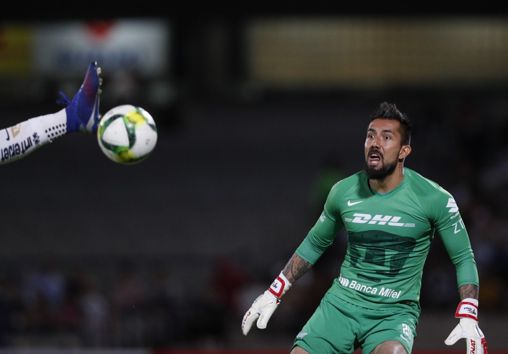 Pumas goalkeeper Miguel Fraga watches as a scoring attempt by Dorados is intercepted by teammate Alan Mendoza, in their Copa MX quarterfinal match at