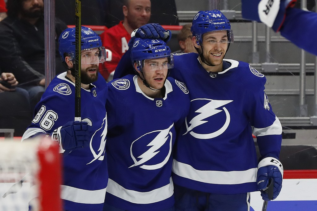 Tampa Bay Lightning center Brayden Point, center, celebrates his goal with Nikita Kucherov (86) and Tampa Bay Lightning defenseman Jan Rutta, right, i