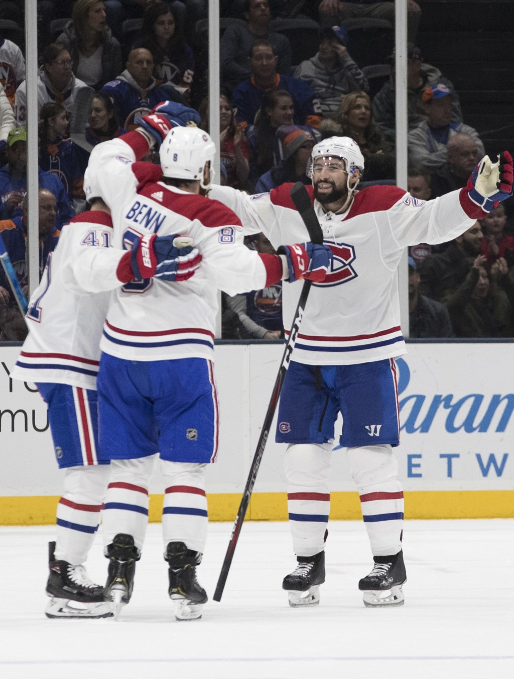 Montreal Canadiens defenseman Jordie Benn, center, celebrates after scoring a goal during the second period of an NHL hockey game against the New York