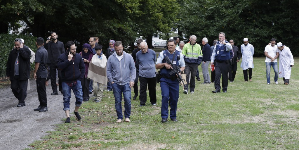 Police escort witnesses away from a mosque in central Christchurch, New Zealand, Friday, March 15, 2019.  Multiple people were killed in mass shooting