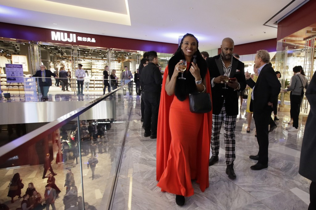 People attend the opening of The Shops & Restaurants at Hudson Yards, Thursday, March 14, 2019, in New York. Hudson Yards, a $25 billion urban complex