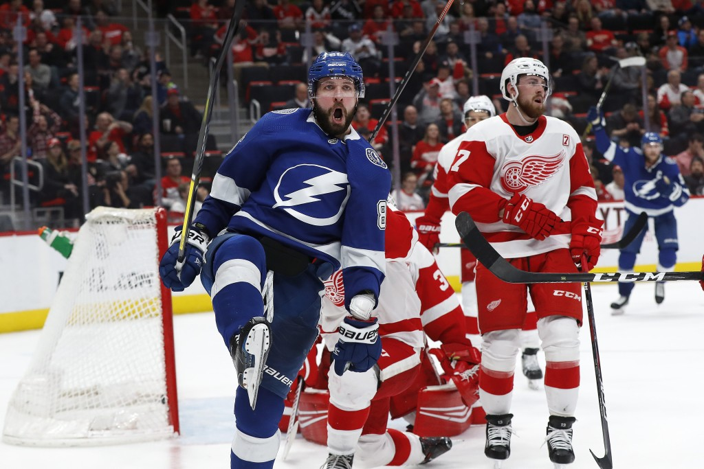 Tampa Bay Lightning's Nikita Kucherov celebrates his goal against the Detroit Red Wings in the third period of an NHL hockey game, Thursday, March 14,