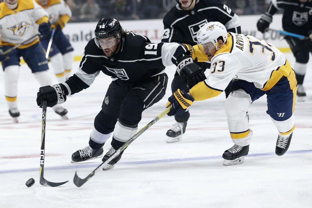 Los Angeles Kings forward Alex Iafallo (19) and Nashville Predators forward Viktor Arvidsson (33) vie for the puck during the second period of an NHL