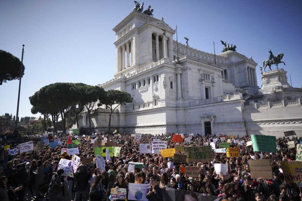 Students gather in front of the monument of the Unknown Soldier to demand action on climate change, in Rome, Friday, March 15, 2019. Students worldwid