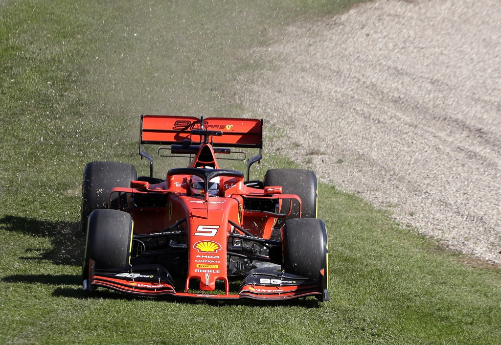 Ferrari driver Sebastian Vettel of Germany leaves the track in the first corner during the second practice session of the Australian Grand Prix in Mel