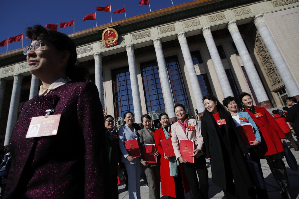 Female delegates leave the Great Hall of the People after attending the closing session of China's National People's Congress (NPC) in Beijing, Friday