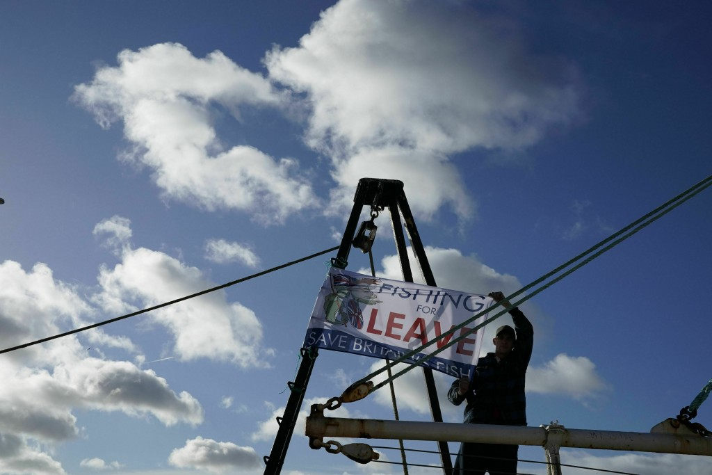 A fisherman joins demonstrators at a pro-Brexit March to Leave protest, at Newcastle Quayside, in Newcastle, England, Friday March 15, 2019. British P
