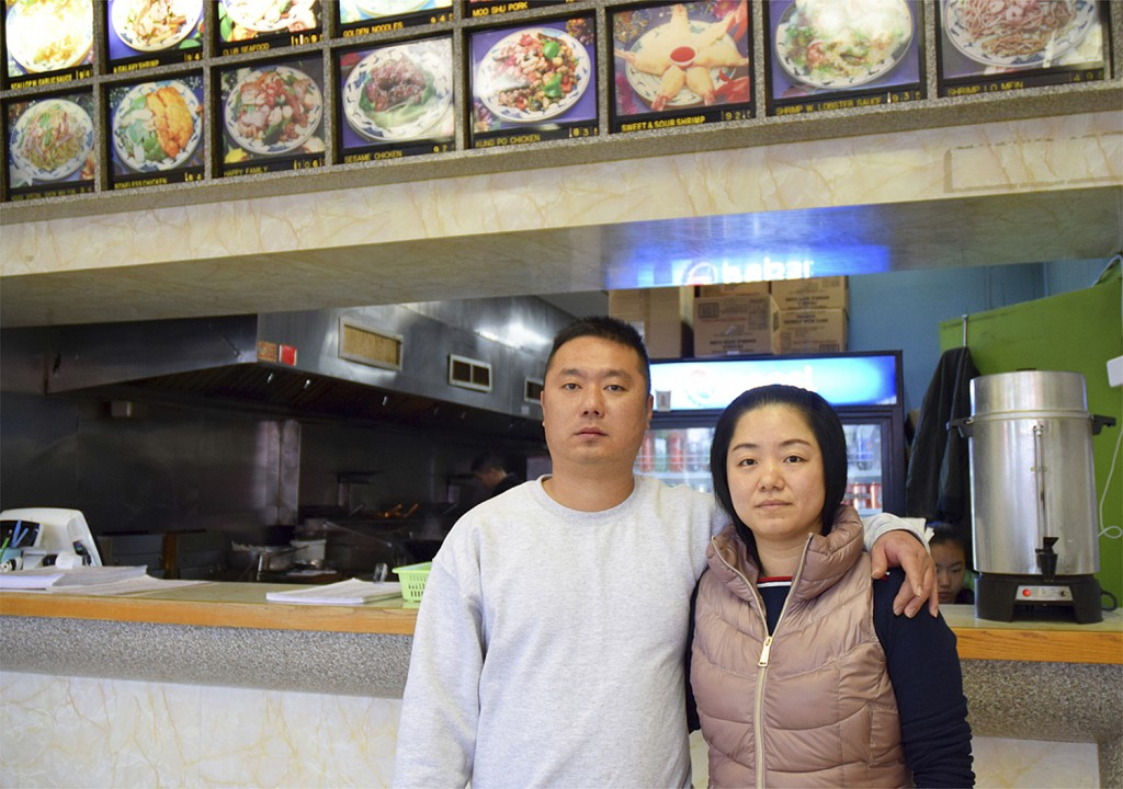 In this undated photo released by Amber Taylor, Wanrong Lin, left, and his wife, Hui Fang Dong, pose for a photo. Wanrong Lin, a Maryland resident who