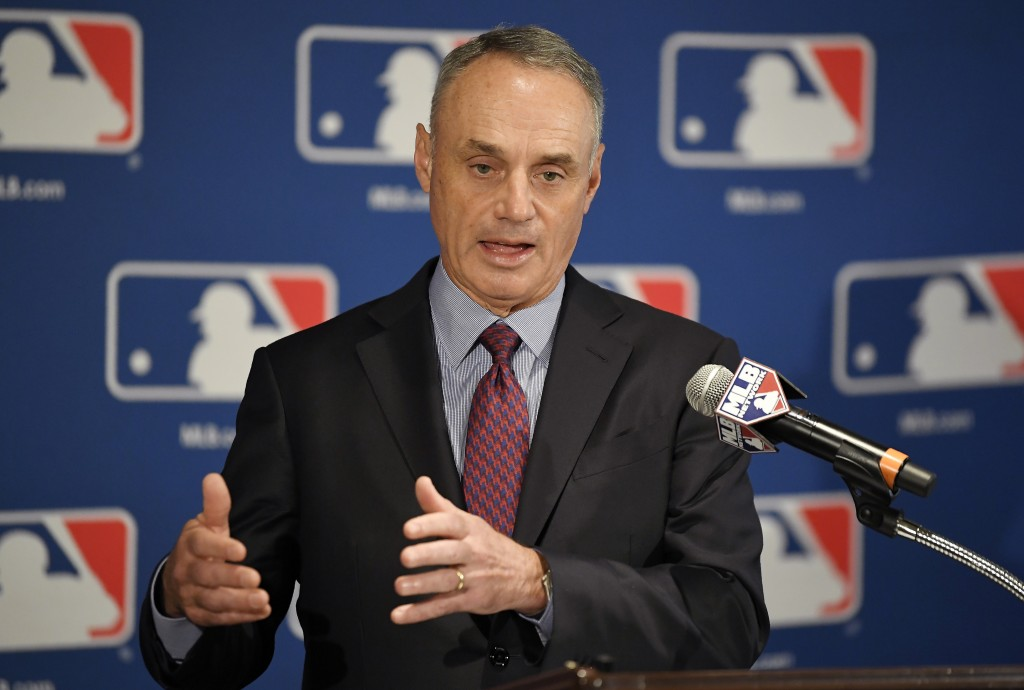 FILE - In this Feb. 1, 2018, file photo, Major League Baseball commissioner Rob Manfred speaks during a news conference in Los Angeles.  Major League ...