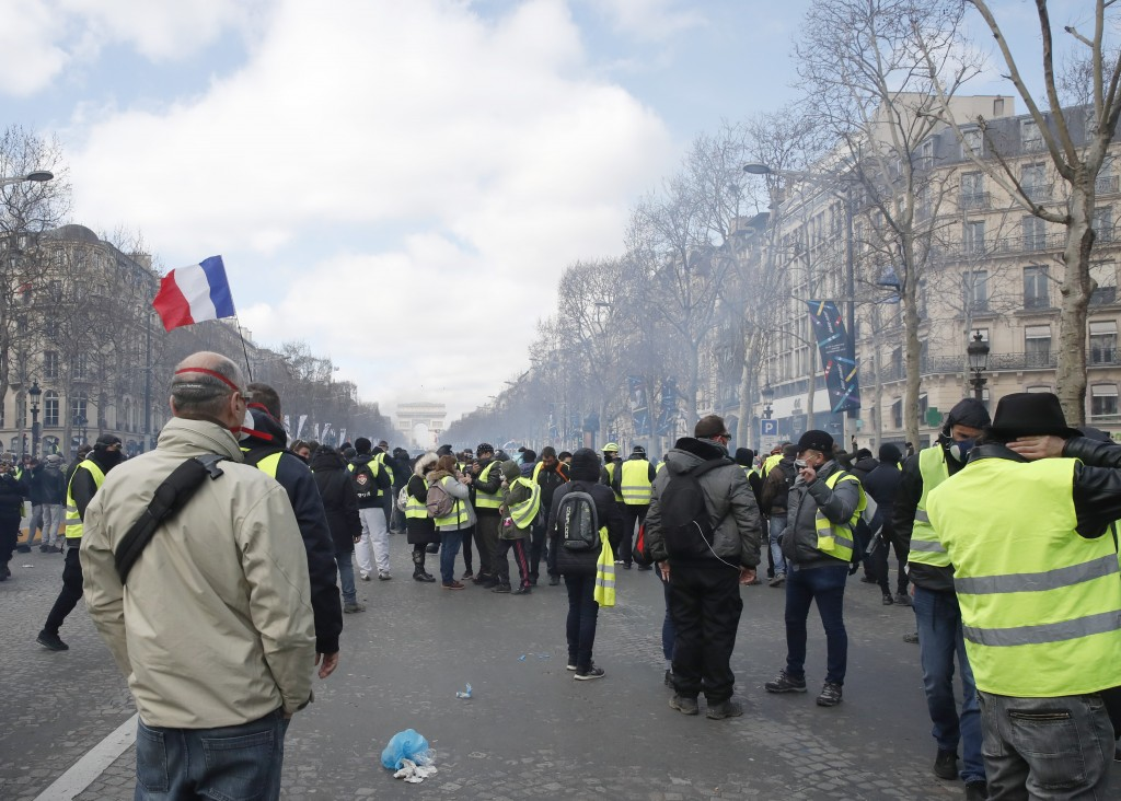 Yellow vests protesters gather on the Champs Elysees avenue Saturday, March 16, 2019 in Paris. French yellow vest protesters clashed Saturday with rio