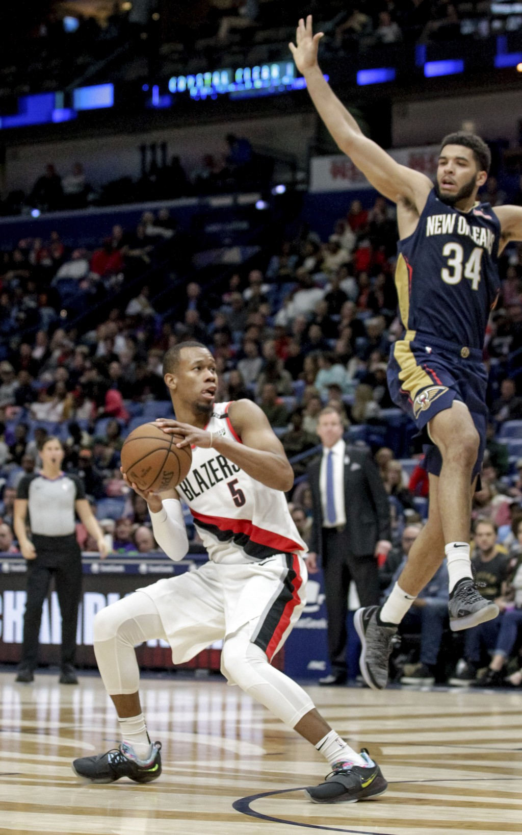 Portland Trail Blazers guard Rodney Hood (5) fakes New Orleans Pelicans guard Kenrich Williams (34) off his feet before scoring against him in the sec
