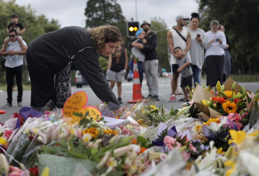 Mourners paying their respects at a makeshift memorial near the Masjid Al Noor mosque, Saturday, March 16, 2019, Christchurch, New Zealand, where one