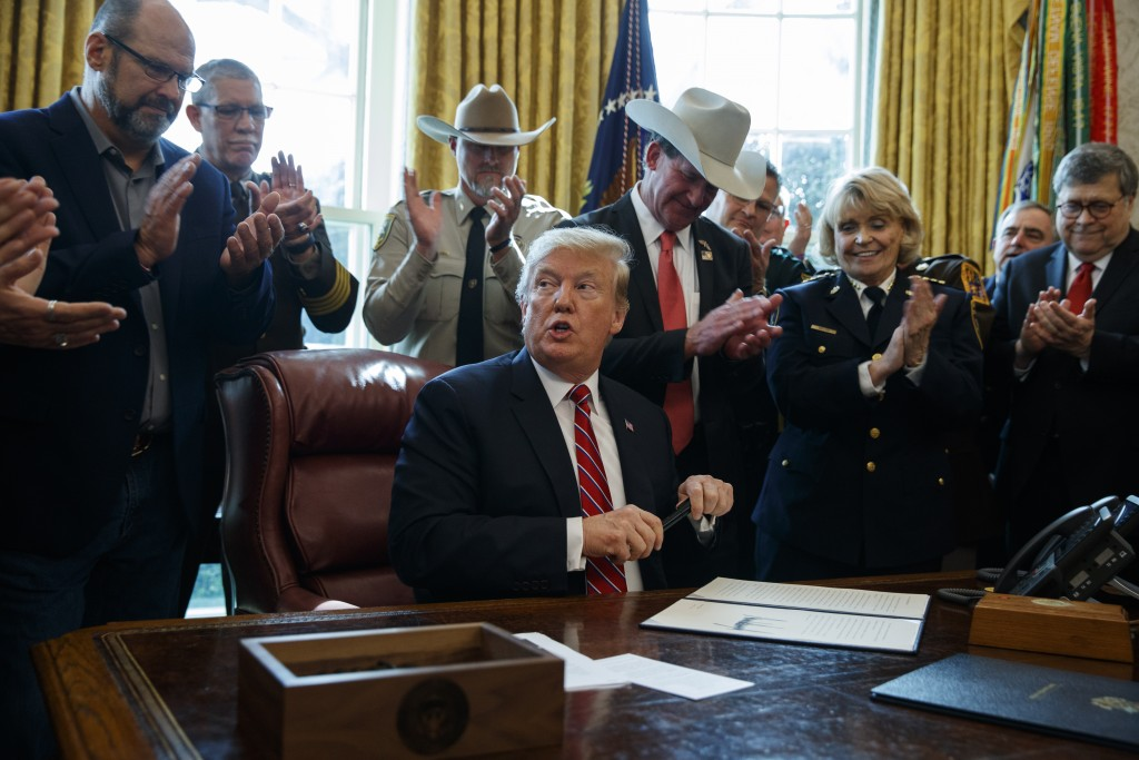 President Donald Trump speaks about border security in the Oval Office of the White House, Friday, March 15, 2019, in Washington. Trump issued the fir