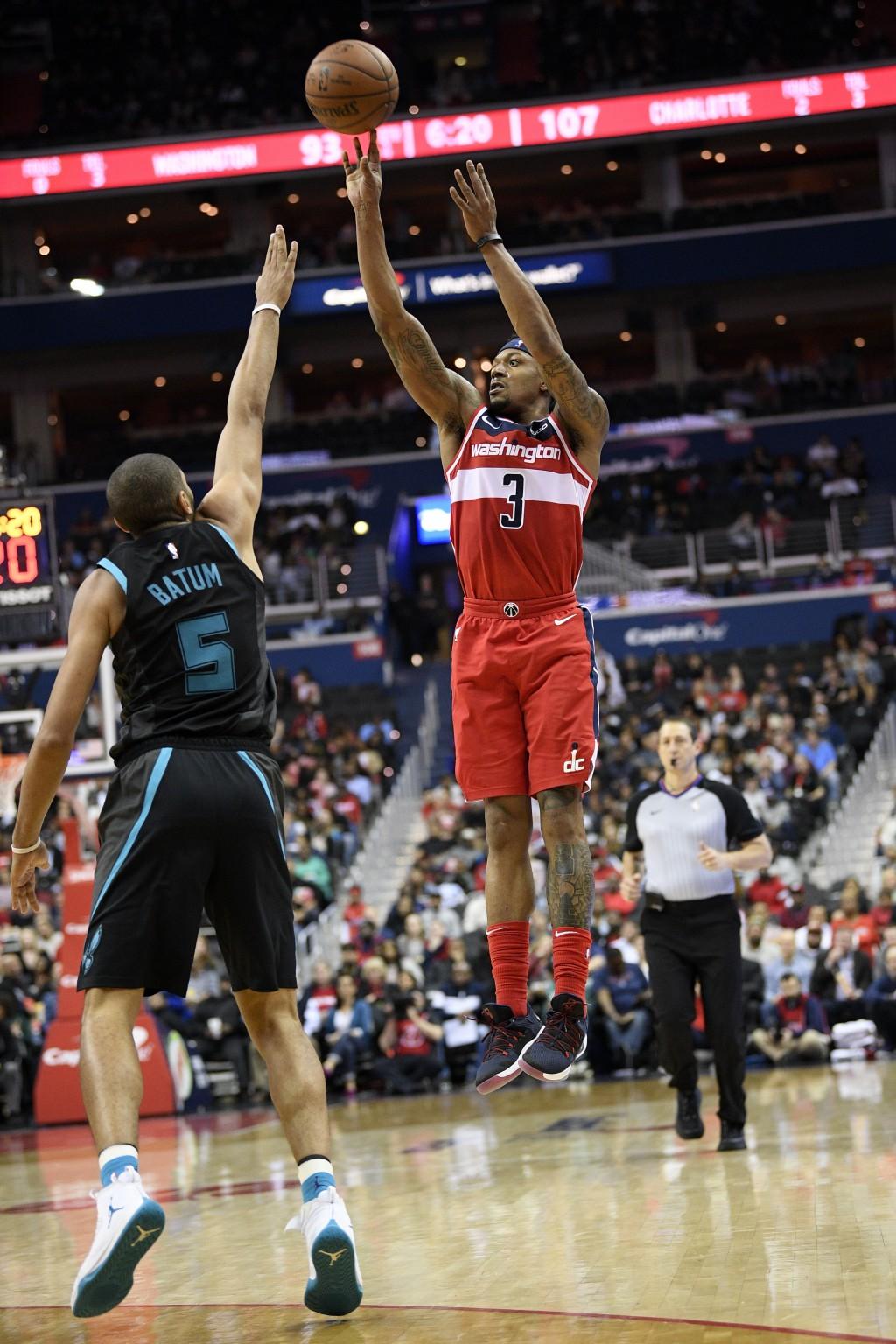 Washington Wizards guard Bradley Beal (3) shoots over Charlotte Hornets forward Nicolas Batum (5) during the second half of an NBA basketball game, Fr