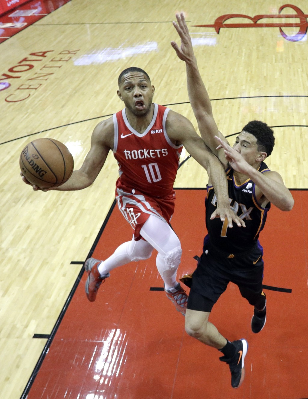 Houston Rockets' Eric Gordon (10) goes up for a shot as Phoenix Suns' Devin Booker (1) defends during the first half of an NBA basketball game Friday,
