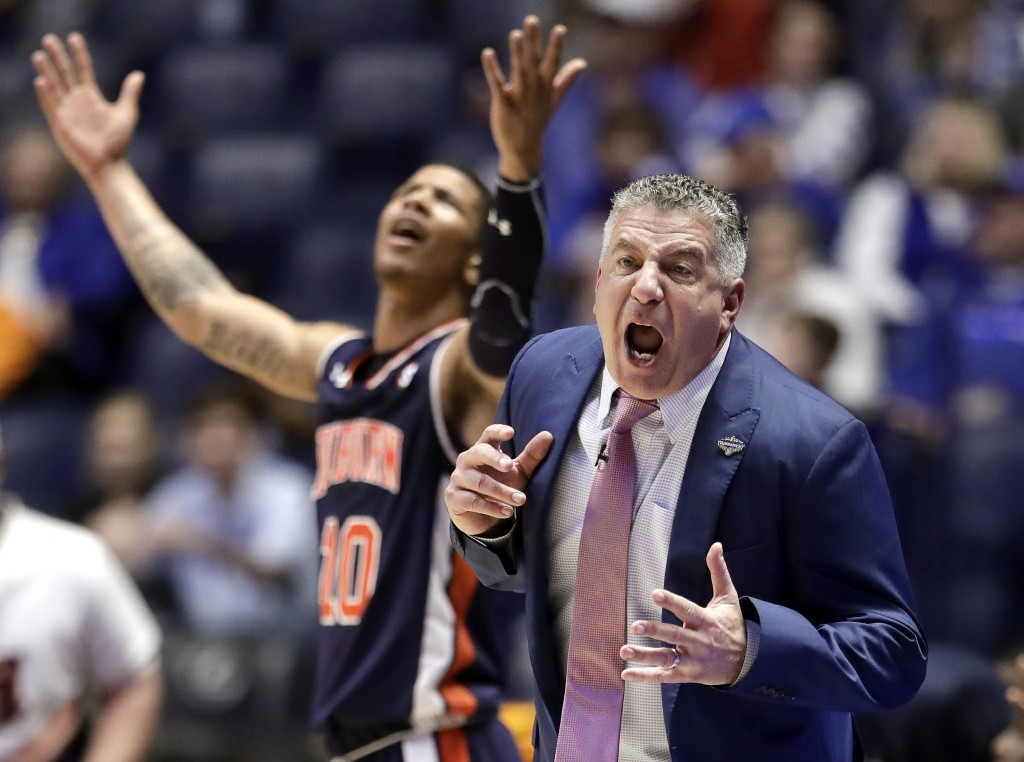 Auburn head coach Bruce Pearl reacts to a call against his team in the first half of an NCAA college basketball game against South Carolina at the Sou