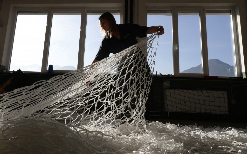 "In this photo taken on Wednesday, Feb. 6, 2019, a woman works at ""La Rete"" (The Net) factory in Monte Isola, Lake Iseo, northern Italy. Step off the f"