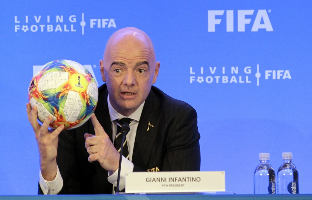 FIFA President Gianni Infantino holds a soccer ball as he speaks during a press conference after the FIFA Council Meeting, Friday, March 15, 2019, in