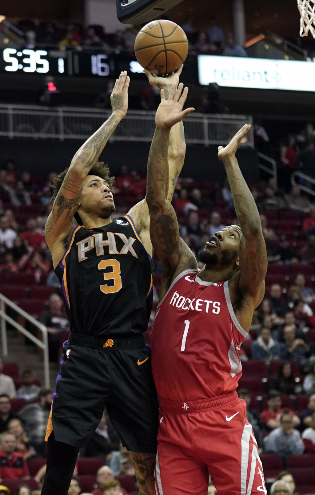 Phoenix Suns' Kelly Oubre Jr. (3) shoots as Houston Rockets' Iman Shumpert (1) defends during the first half of an NBA basketball game Friday, March 1