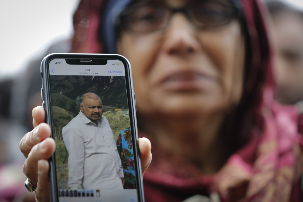 Akhtar Khokhur, 58, shows a picture of her missing husband Mehaboobbhai Khokhar during an interview outside an information center for families, Saturd