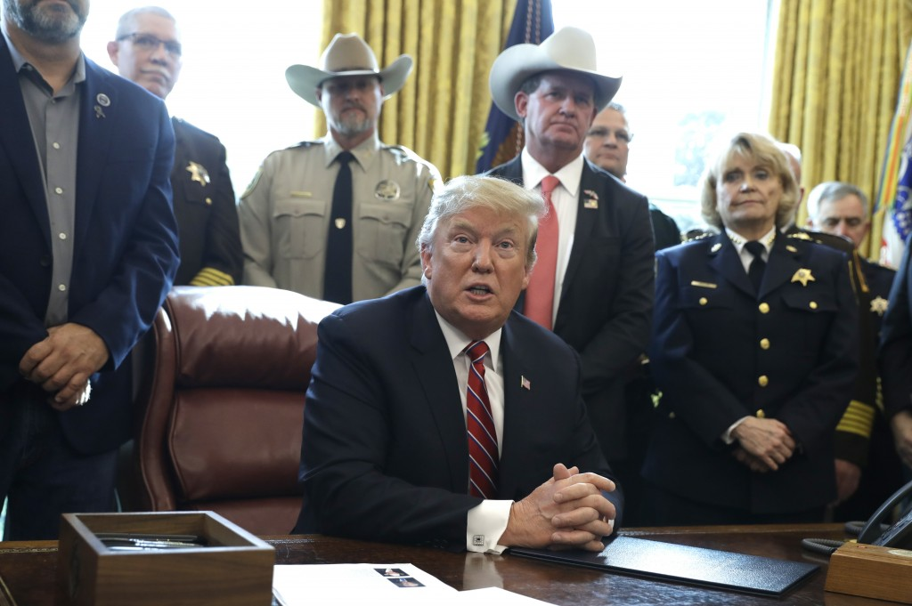 In this March 15, 2019, photo, President Donald Trump speaks about border security in the Oval Office of the White House, Friday, March 15, 2019, in W