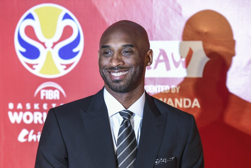 Former basketball player Kobe Bryant reacts prior to the draw ceremony of 2019 FIBA Basketball World Cup in Shenzhen, in southern China's Guangdong Pr