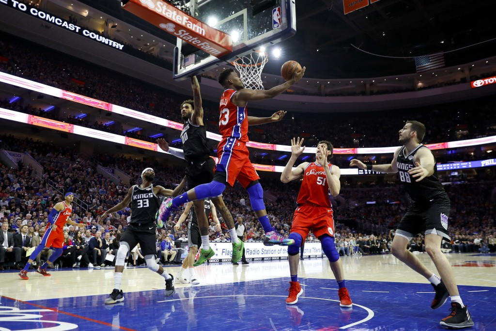 Philadelphia 76ers' Jimmy Butler (23) goes up for a shot against Sacramento Kings' Willie Cauley-Stein (00) during the first half of an NBA basketball