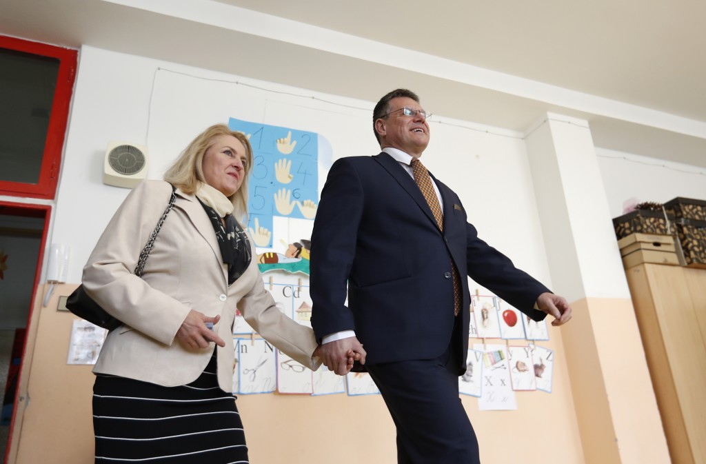 Presidential candidate and European Commission Vice-President Maros Sefcovic accompanied with his wife Helena arrives to cast his vote at a polling st