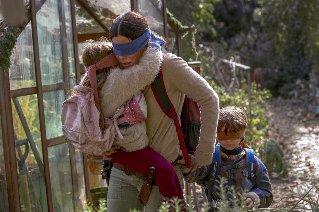 """This image released by Netflix shows Sandra Bullock in a scene from the film, """"Bird Box."""" Netflix will remove footage of a real fiery train disaster f"""