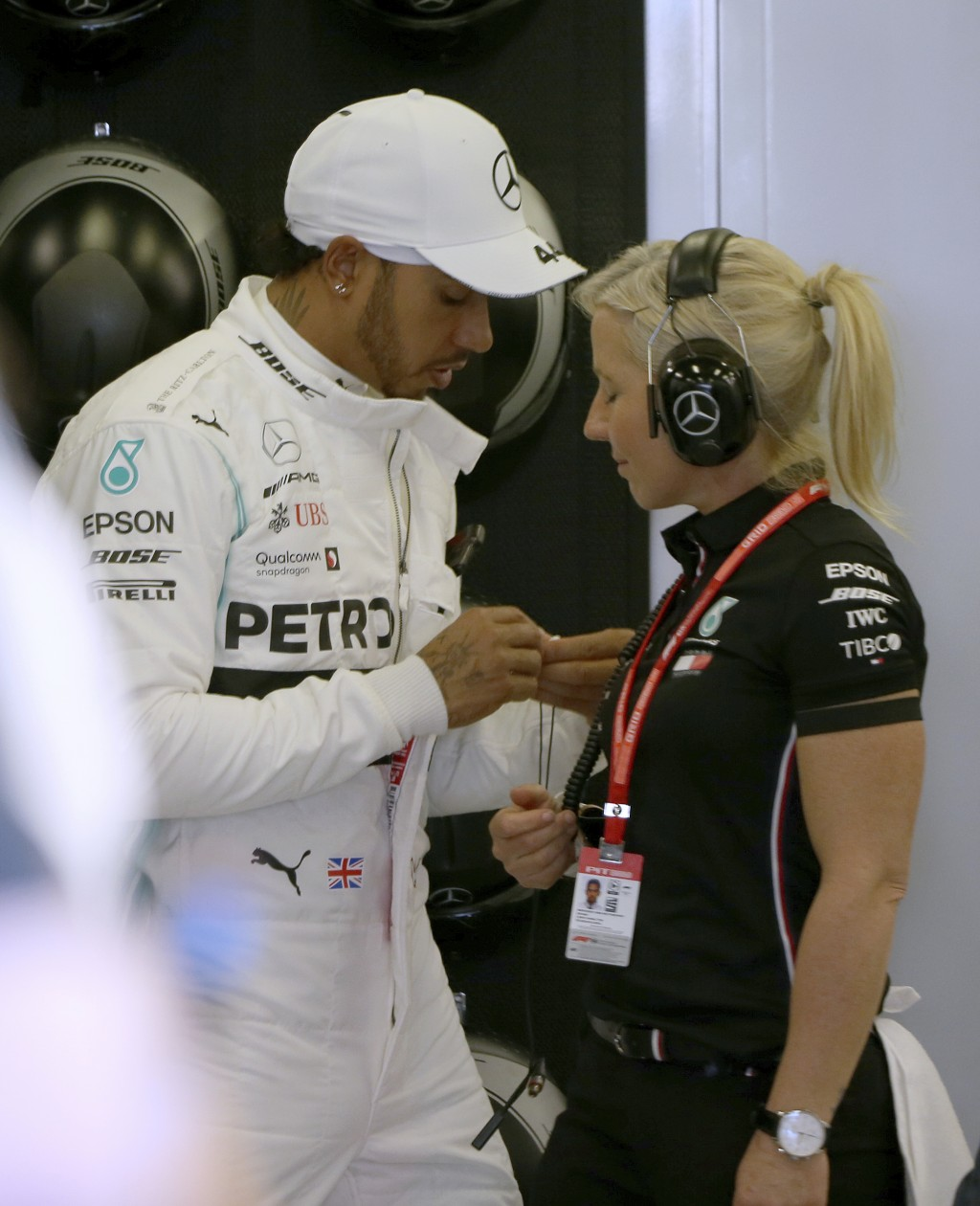 Mercedes driver Lewis Hamilton of Britain, left, prepares for the final practice session for the Australian Grand Prix in Melbourne, Australia, Saturd