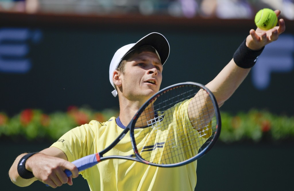 Hubert Hurkacz, of Poland, serves to Roger Federer, of Switzerland, at the BNP Paribas Open tennis tournament Friday, March 15, 2019, in Indian Wells,