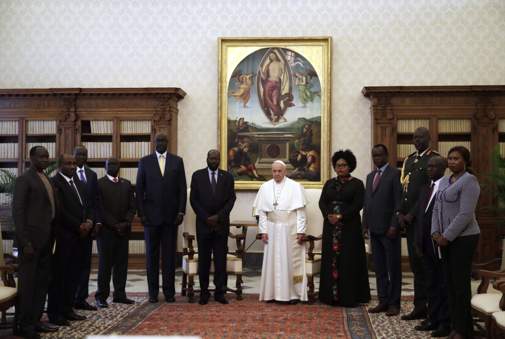Pope Francis, flanked at left, by South Sudan President Salva Kiir Mayardit poses with members of the delegation at the end of their private audience