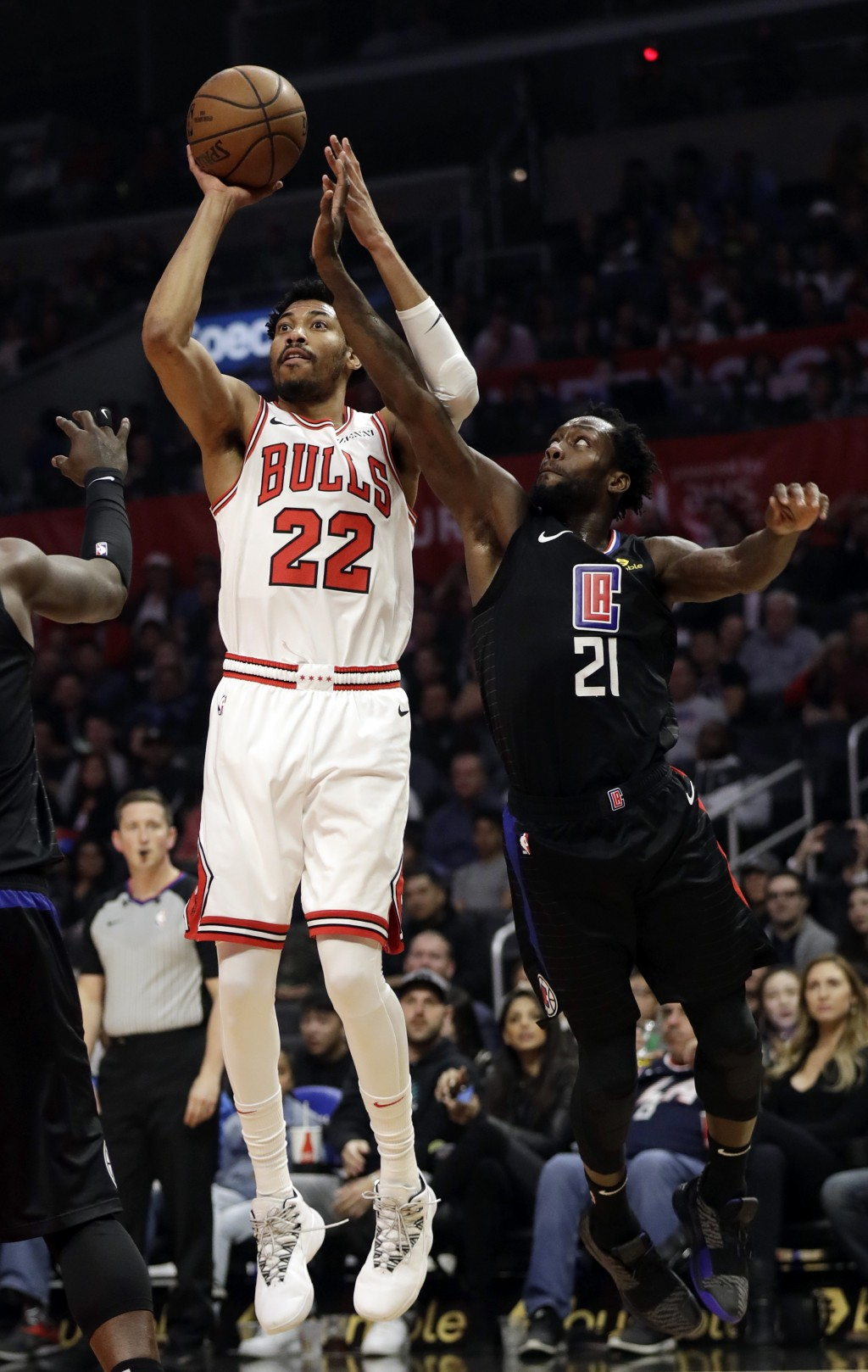 Chicago Bulls' Otto Porter Jr. (22) shoots next to Los Angels Clippers' Patrick Beverley (21) during the first half of an NBA basketball game Friday,