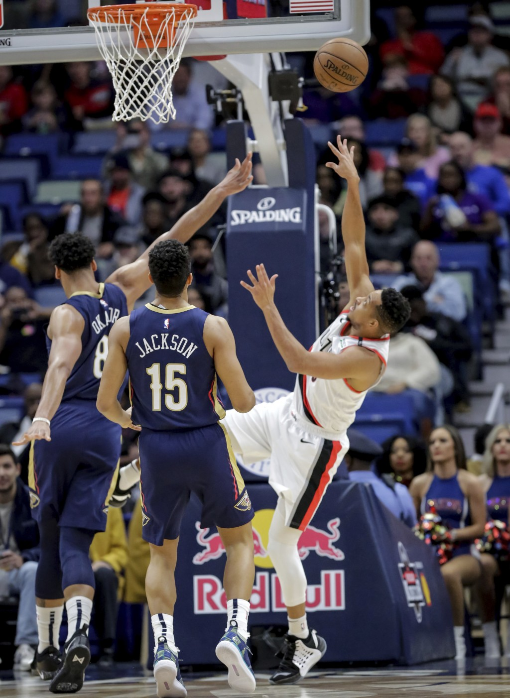 Portland Trail Blazers guard CJ McCollum (3) is fouled by New Orleans Pelicans center Jahlil Okafor (8) as guard Frank Jackson (15) trails the play in