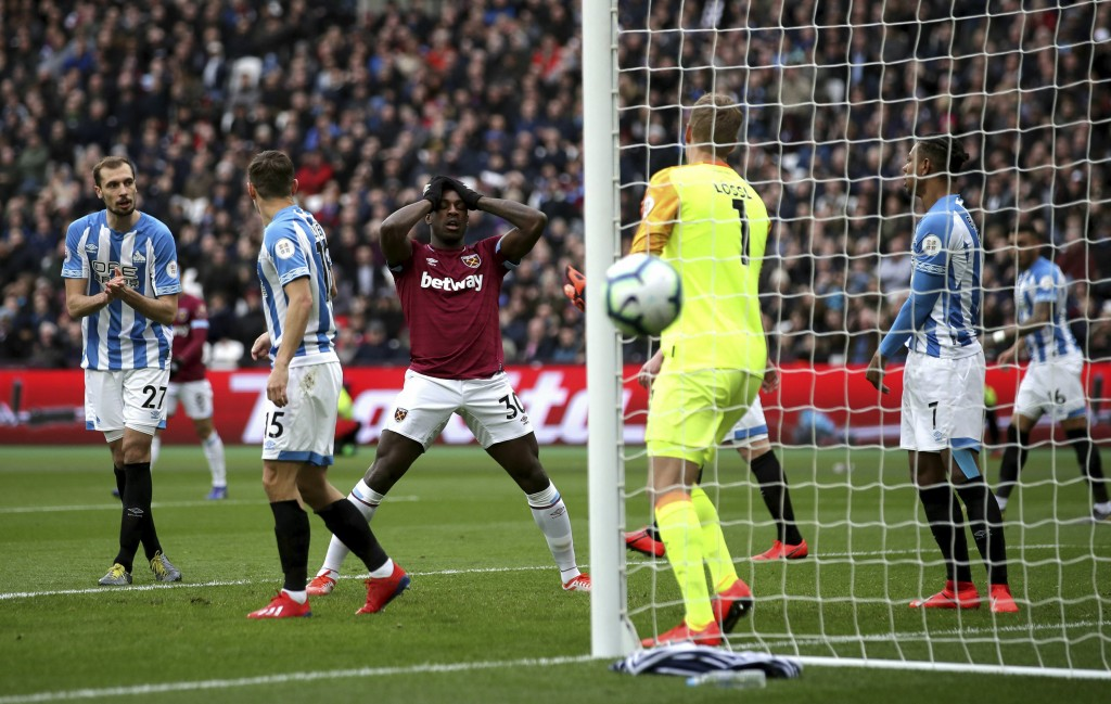 West Ham United's Michail Antonio, center, rues a missed chance during during the English Premier League soccer match between West Ham United and Hudd