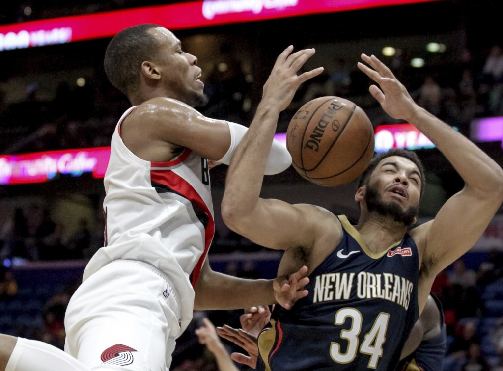 Portland Trail Blazers guard Rodney Hood (5) is fouled by New Orleans Pelicans guard Kenrich Williams (34) in the second half of an NBA basketball gam