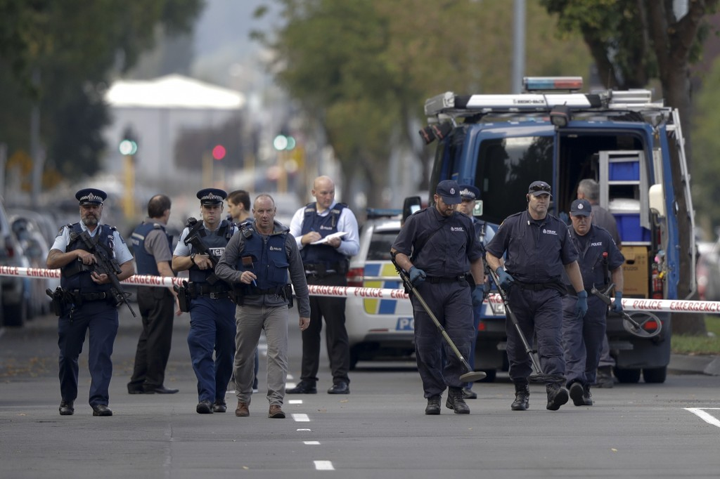 Police officers search the area near the Masjid Al Noor mosque, site of one of the mass shootings at two mosques in Christchurch, New Zealand, Saturda