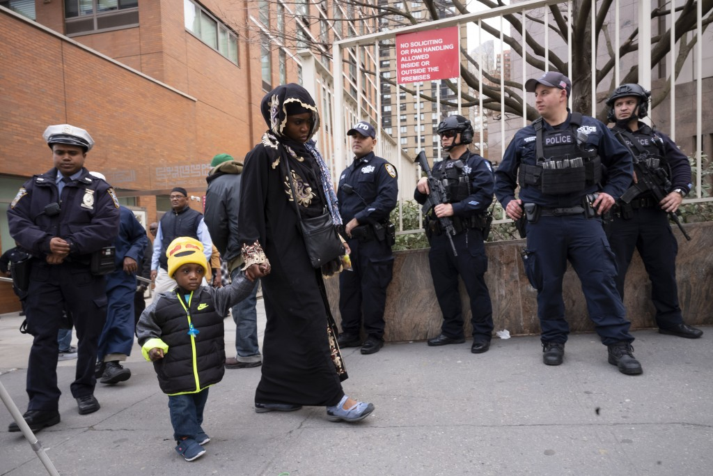 People leave the Islamic Cultural Center of New York under increased police security following the shooting in New Zealand, Friday, March 15, 2019, in