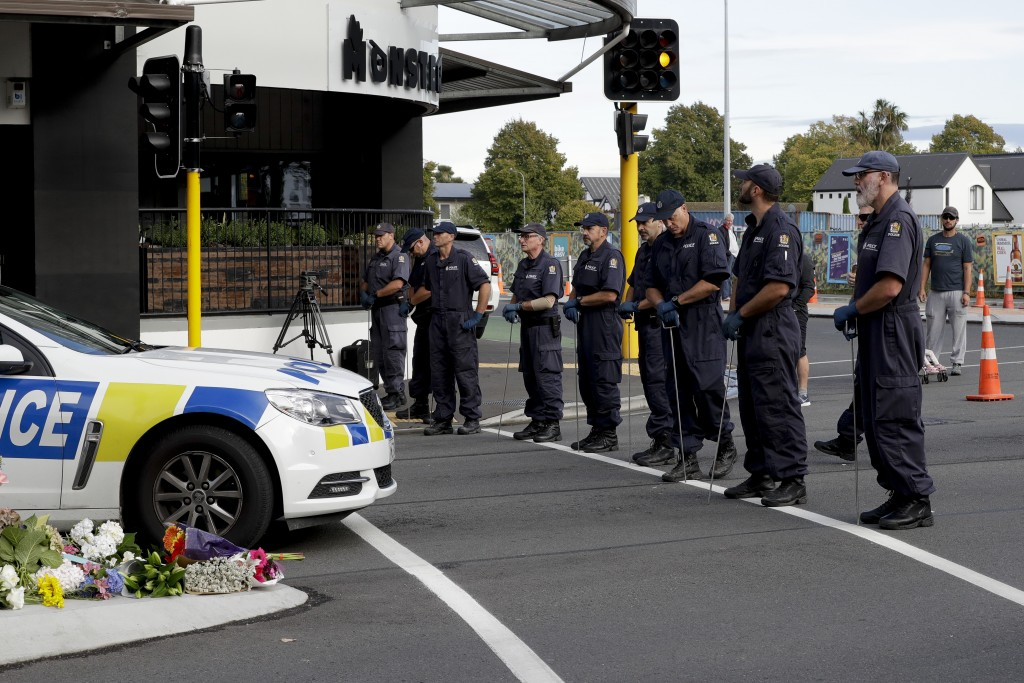 Police officers prepare to search the area near the Masjid Al Noor mosque, site of one of the mass shootings at two mosques in Christchurch, New Zeala