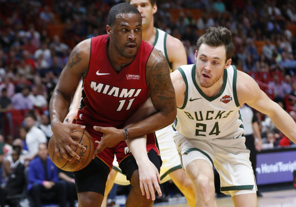 Miami Heat guard Dion Waiters (11) and Milwaukee Bucks guard Pat Connaughton (24) compete for a loose ball during the first half of an NBA basketball
