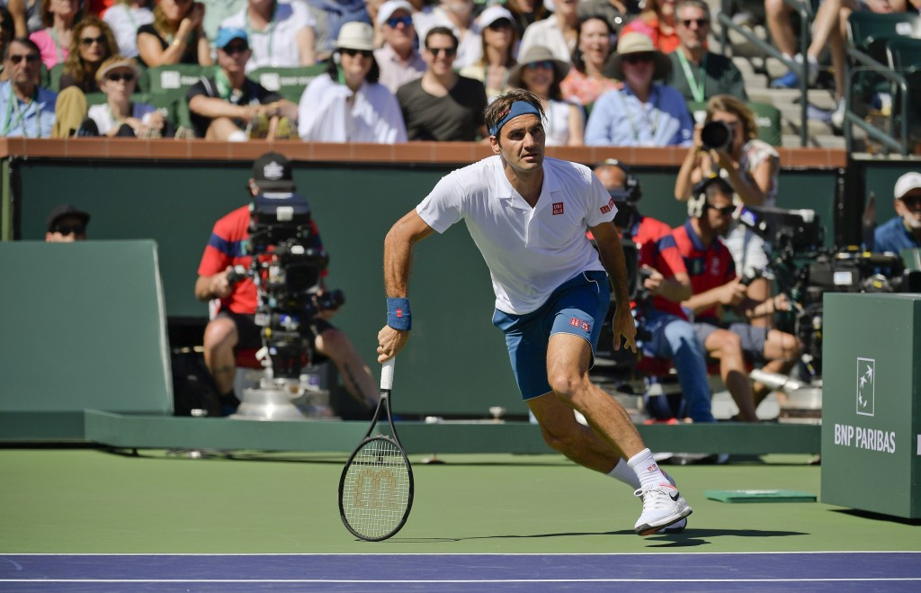 Roger Federer, of Switzerland, chases a ball against Hubert Hurkacz, of Poland at the BNP Paribas Open tennis tournament Friday, March 15, 2019, in In