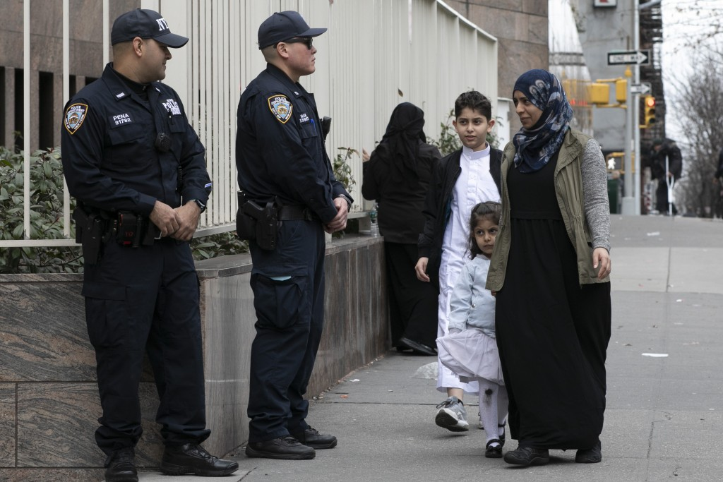 Worshippers arrive for service at the Islamic Cultural Center of New York under increased police security following the shooting in New Zealand, Frida