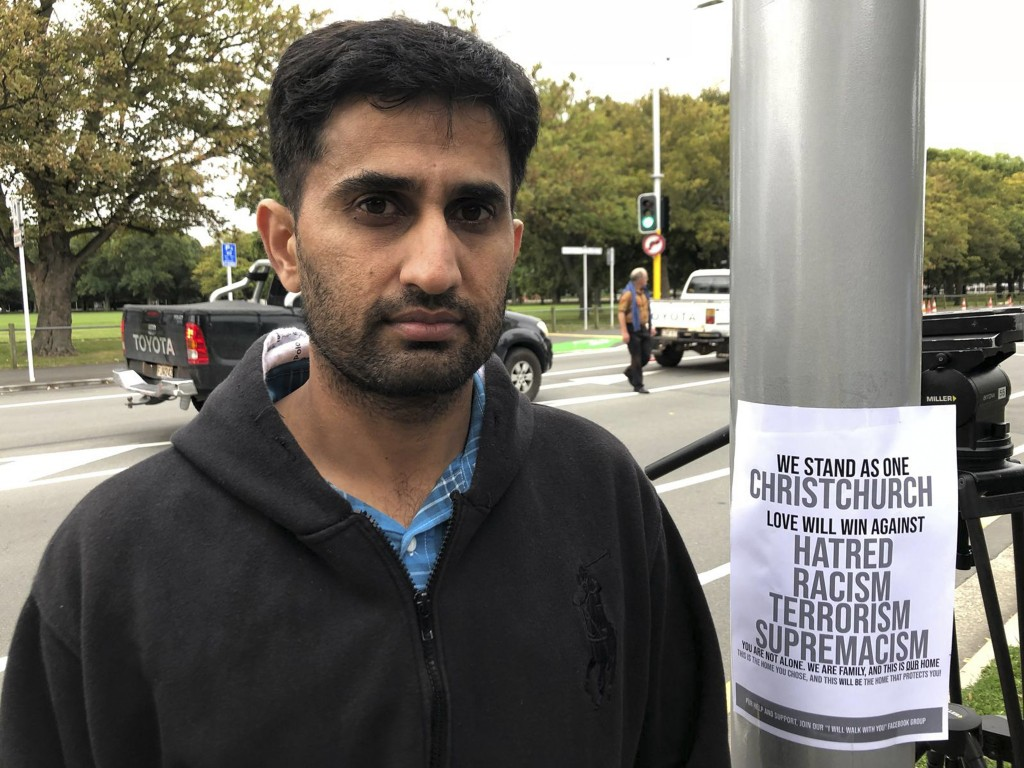 Yasir Amin, 35-year-old, describes his run-in with the gunman in Friday's mass shootings Saturday, March 16, 2019, in Christchurch, New Zealand. (AP P