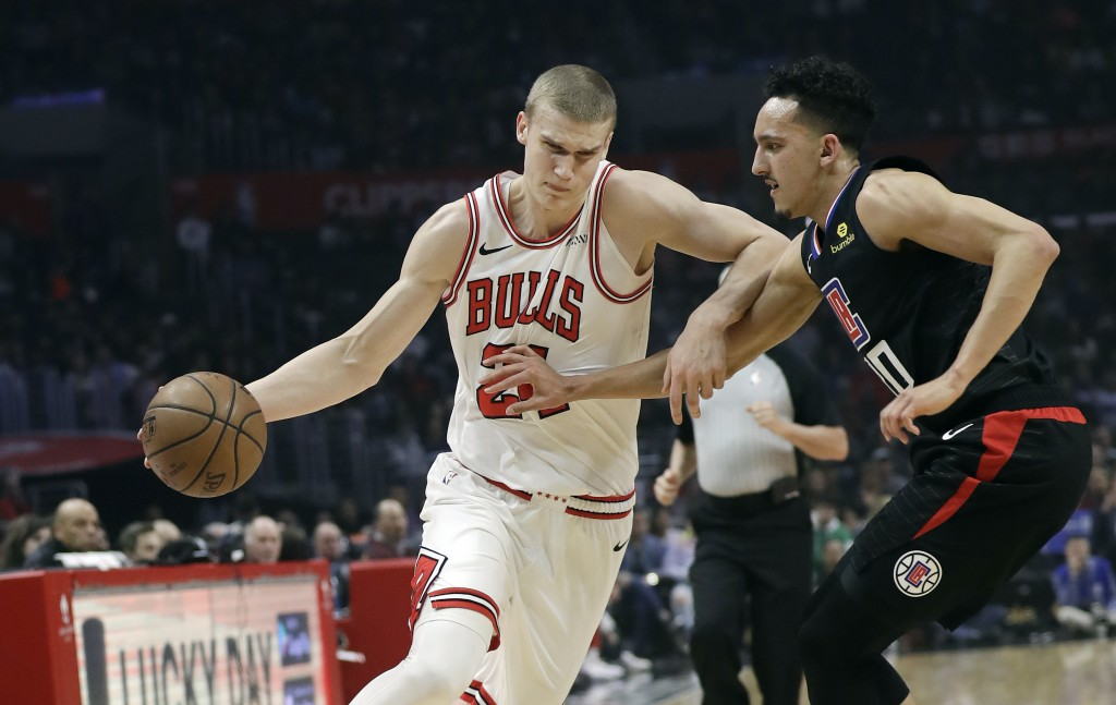 Chicago Bulls' Lauri Markkanen, left, is defended by Los Angels Clippers' Landry Shamet during the first half of an NBA basketball game Friday, March