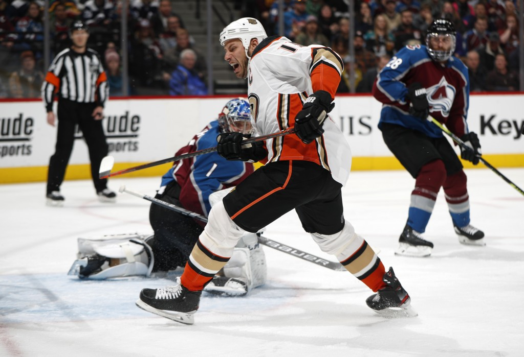 Anaheim Ducks center Ryan Getzlaf, front, pursues the puck as Colorado Avalanche goaltender Semyon Varlamov looks for it during the second period of a