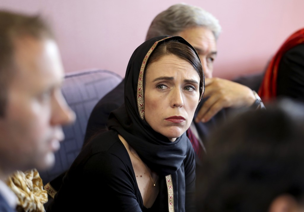 In this photo released by New Zealand Prime Minister's Office, Prime Minister Jacinda Ardern, center, meets representatives of the Muslim community, S