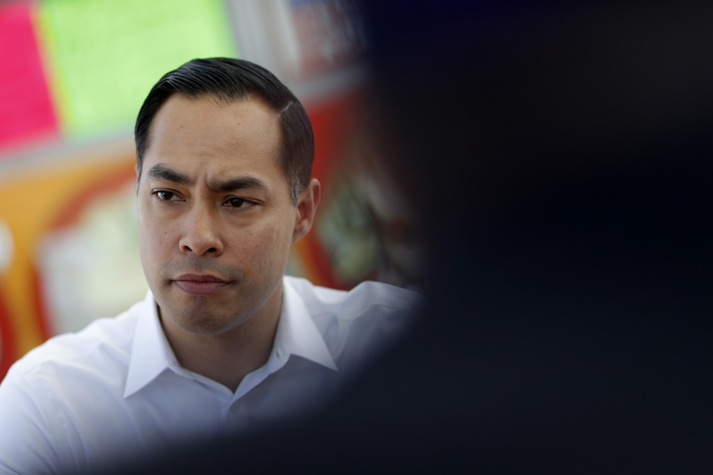 FILE - In this Feb. 28, 2019 file photo, former Housing and Urban Development Secretary and Democratic presidential candidate Julian Castro visits wit