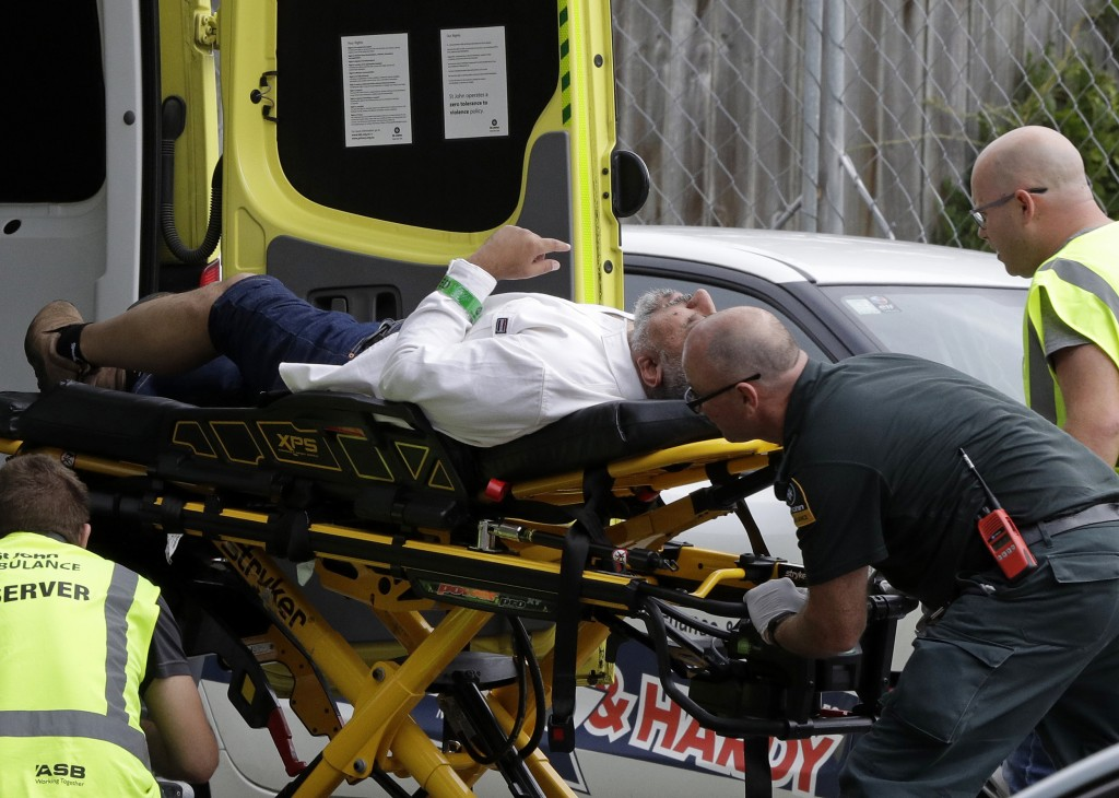 Ambulance staff take a man from outside a mosque in central Christchurch, New Zealand, Friday, March 15, 2019, following a mass shooting. (AP Photo/Ma